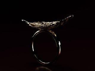 Rings with a Feather. Sophisticated jewelry design. Sculpted jewellery.