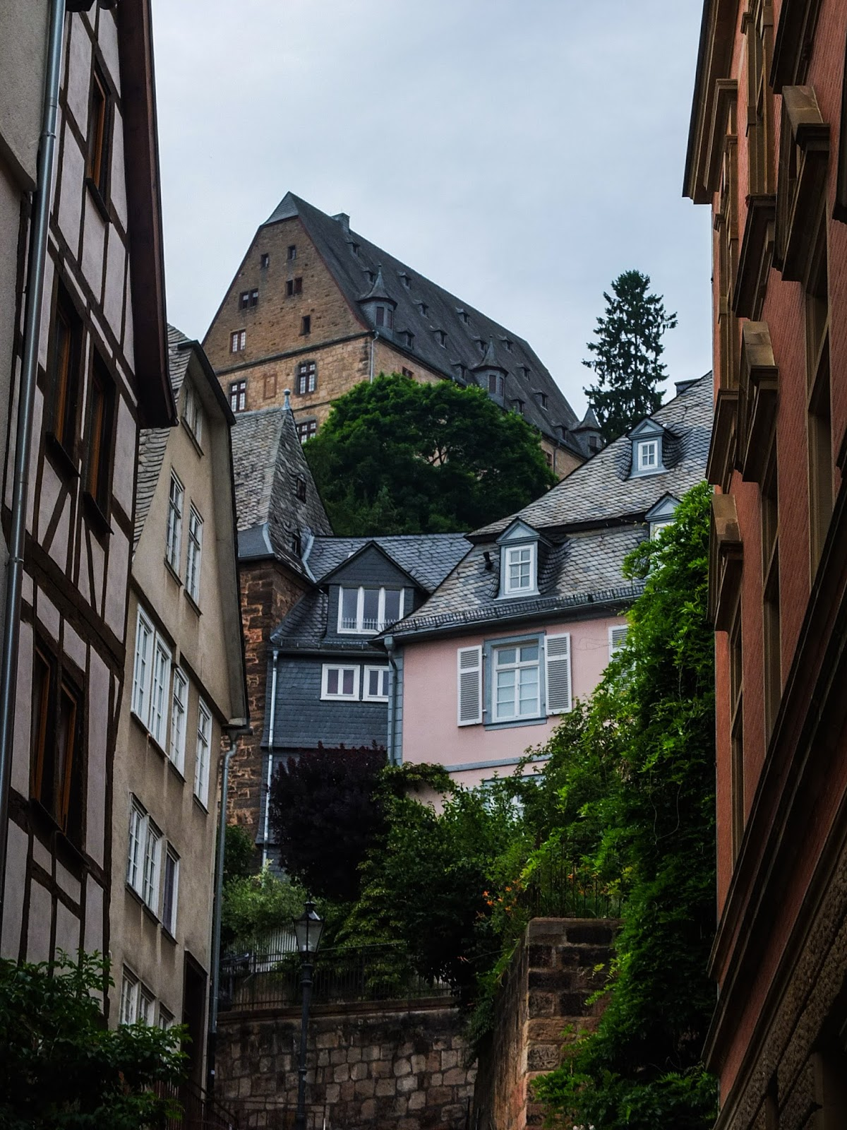 View between buildings in Marburg looking to other buildings up the hill.