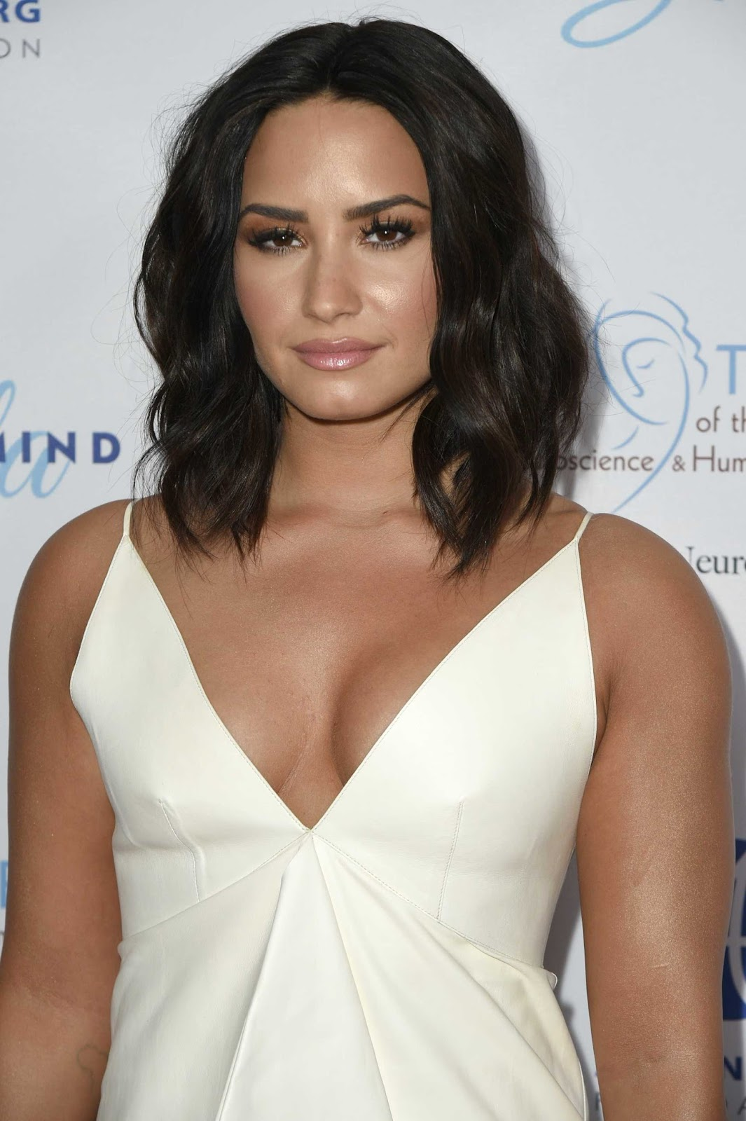 Demi Lovato wears plunging white gown to the Open Mind Gala at UCLA