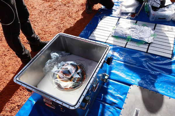 Hayabusa2's sample return capsule is placed inside a special container at the Woomera landing site in Australia...on December 6, 2020 (Japan Time).