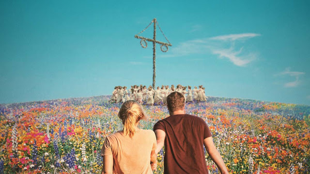 a man and woman walk up a hill