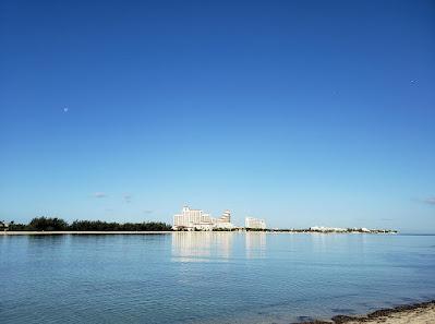 Hotel across calm sea bay