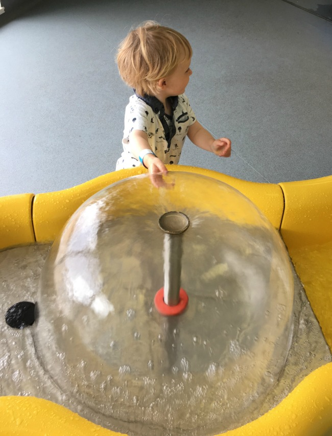 toddler-with-hand-in-fountain