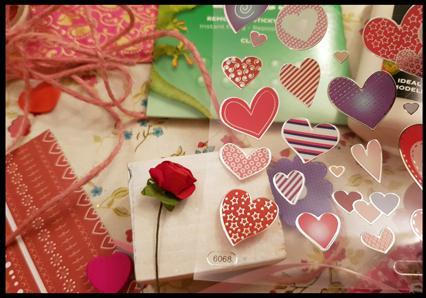 Choosing Sticks and hearts to decorate valentine blocks