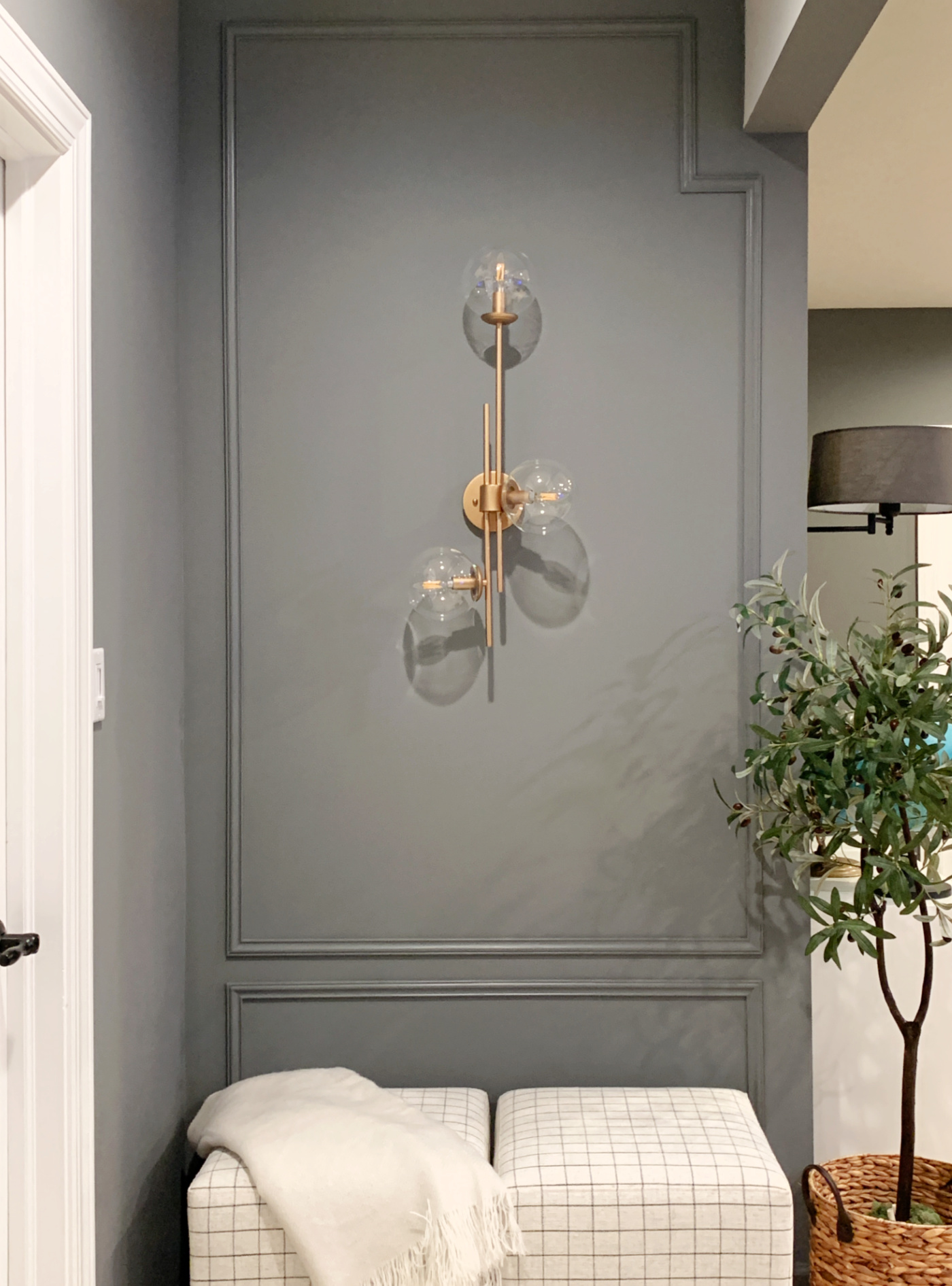 Westchester Gray accent wall with brass sconce