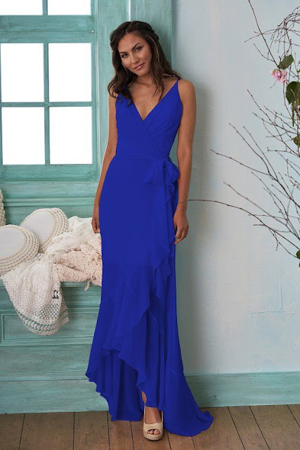 Dresses your bridesmaids will love and can wear again after the wedding - wedding dress ideas - blue v-neckline and spaghetti strap high-low poly chiffon dress - wedding ideas blog - K'Mich Weddings Philadelphia - jasminbridal.com