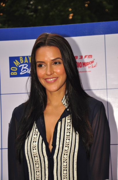 Neha Dhupia's sexy toned legs at Gillette event