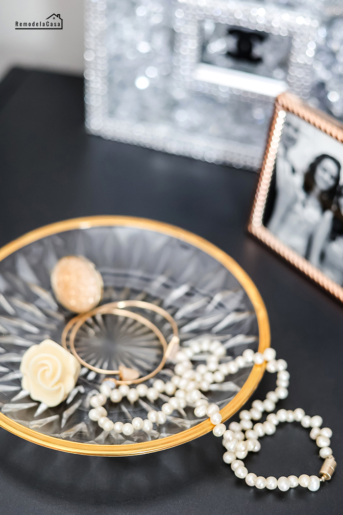 Nightstand with jewelry on a gold and crystal plate