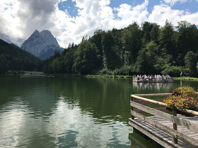 Round trip on the lake with the raft, Wedding abroad, Mountain wedding lake-side at the Riessersee Hotel Resort Bavaria, Germany, Garmisch-Partenkirchen