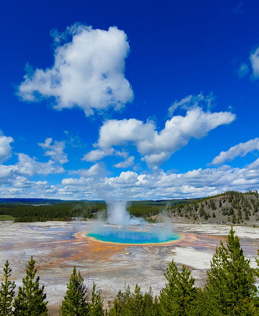 Steam rising from a beautiful, colorful hot spring
