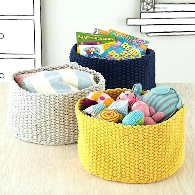 Coloerd baskets organizer with hampers and towels