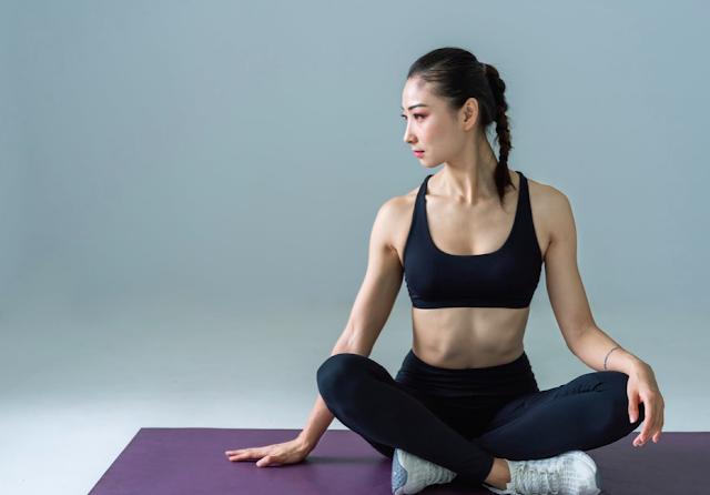 Girl Doing Yoga On Yoga Mat