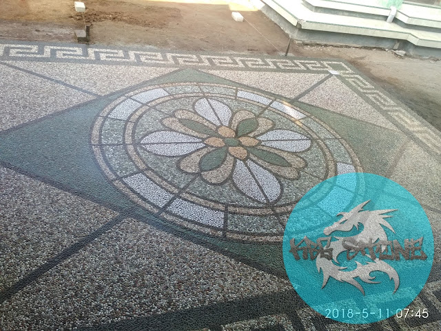 Batu sikat motif bunga
