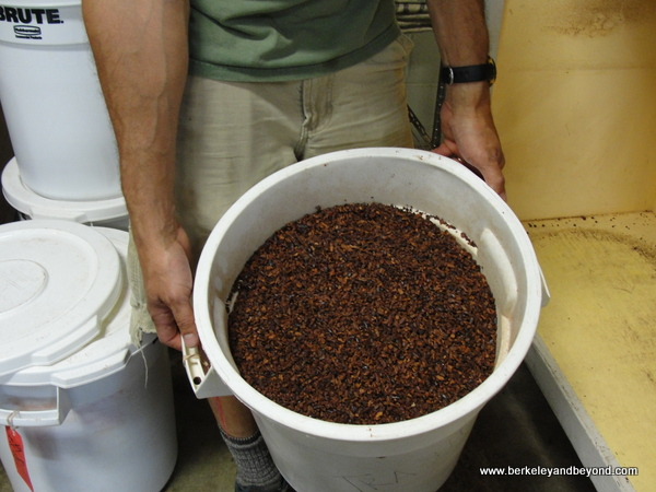 bucket of chocolate nibs at Dick Taylor Craft Chocolate in Eureka, California