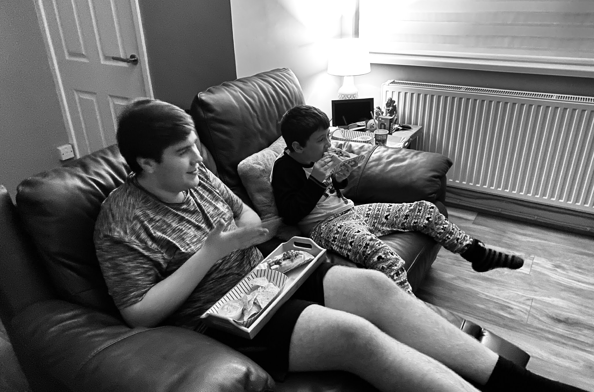 boys sat watching a film
