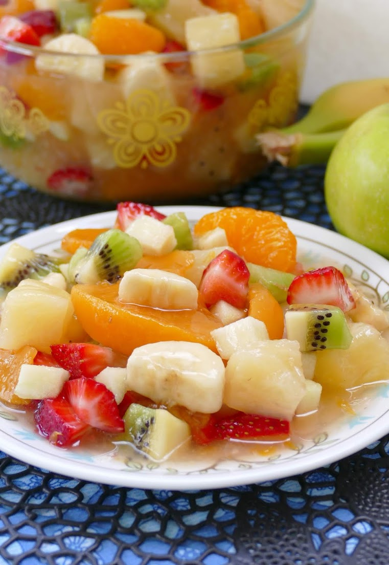 This super easy tropical fruit salad is great for breakfast, snack or dessert! Peaches, pineapple, strawberries, kiwi, oranges, banana and apples give this salad a wonderful flavor. We love serving it at parties, picnics, holidays and BBQ's!