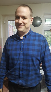 Flyfour wearing a Plaid shirt