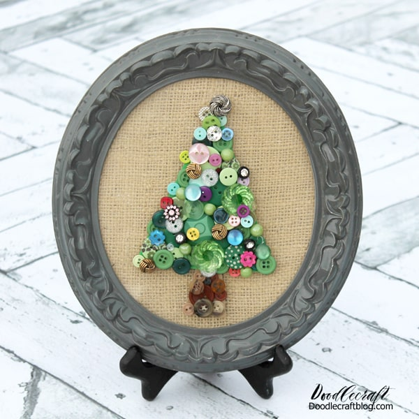 Jeweled Button Christmas Tree  Make a stunning decoration piece with some old buttons. I inherited a few button boxes in my days, so this one was easy for me. Packs of buttons can also be found at the dollar store. Find a simple frame, add some burlap and boom--perfection!