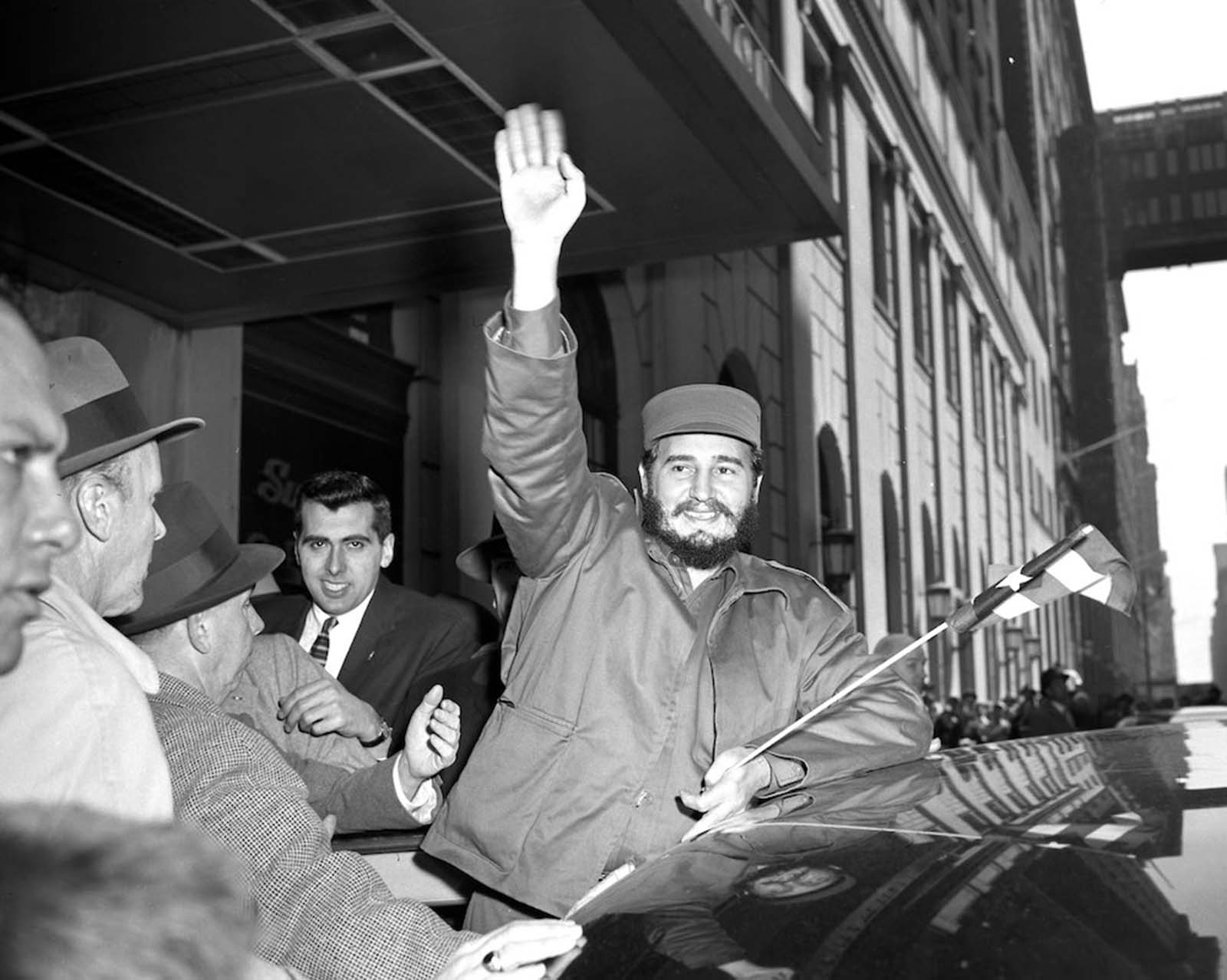 Castro waves to crowds outside the Statler Hotel.