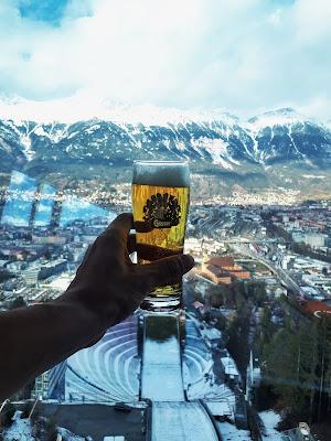 Drinking a beer at Bergisel Olympic ski jump in Innsbruck Austria