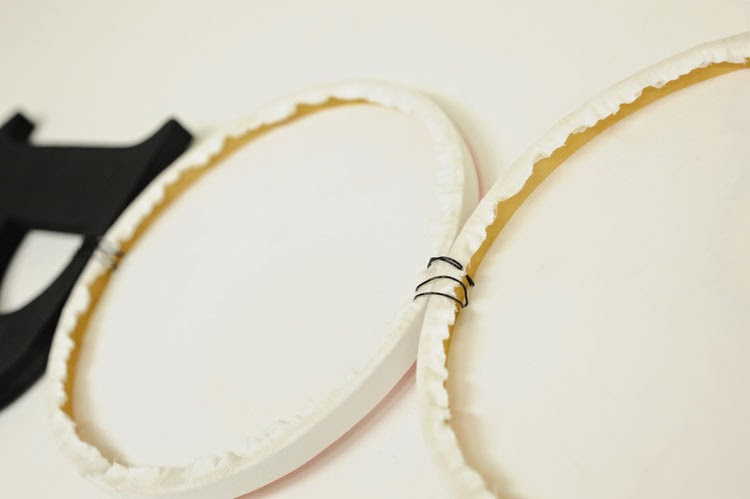 Tie hoops and letter together with wire.