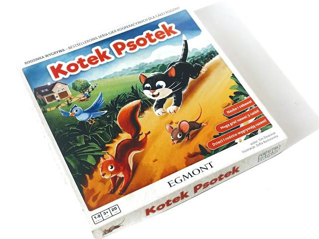 na zdjęcie pudełko gry kotek psotek, na ilustracji widzimy kotka ścigającego wiewiórkę, mysz i ptaka
