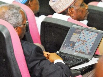 delegate playing scrabble laptop