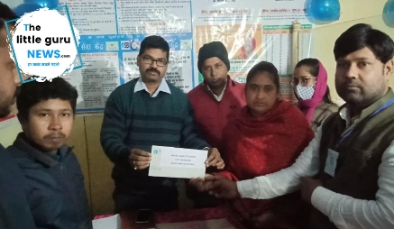 A check of two lakhs handed over to the beneficiary.