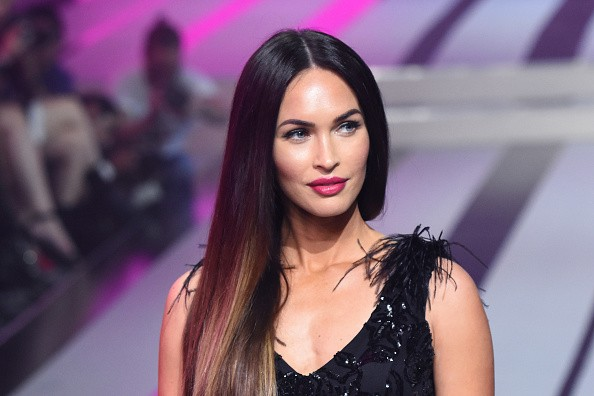 Megan Fox dazzles in a semi-sheer feathered gown at the Fashion Fest AW17 show in Mexico