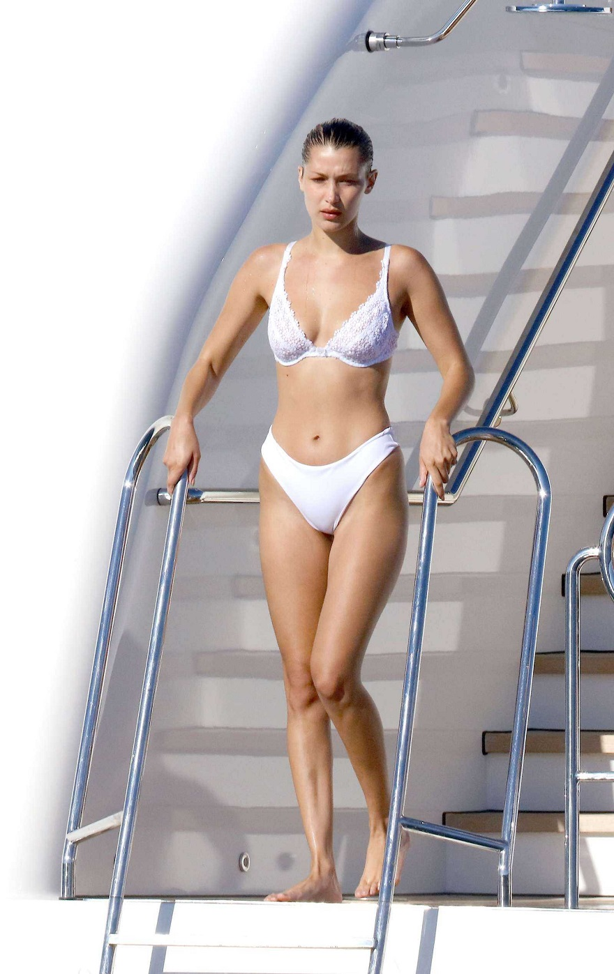 Playful Bella Hadid displays entirety of her peachy derriere through lingerie-inspired bikini while launching herself into the ocean during fun-filled day in Cannes