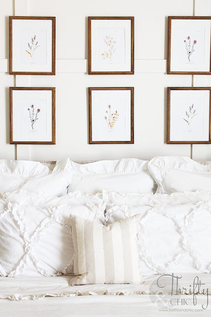 Summer decor and decorating ideas for master bedroom. Gallery wall in bedroom or above bed. Cottage farmhouse decor. White and neutral master bedroom. Vaulted ceilings in master bedroom ideas.