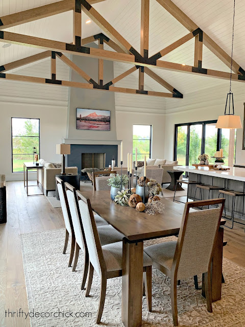 Farmhouse great room with tall fireplace and wood beams
