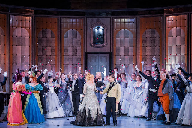 Heather Lowe as Tisbe, Fleur de Bray as Clorinda, Victoria Simmons as Angelina, Nico Darmanin as Prince Ramiro, Jonathan Veira and the Opera Holland Park Chorus in La Cenerentola at Opera Holland Park. Photographer Robert Workman.