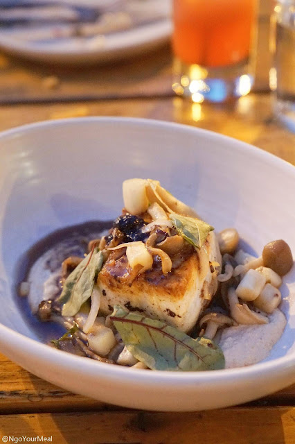 Pan Roasted Halibut with Marcona Almond Butter, White Asparagus, Blueberry Nuoc Cham, Beech Mushroom at the Girl and The Goat in Chicago