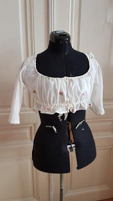 front bodice of a regency dress on a black dress doll