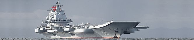 China's Carrier Group Conducts Exercises In South China Sea