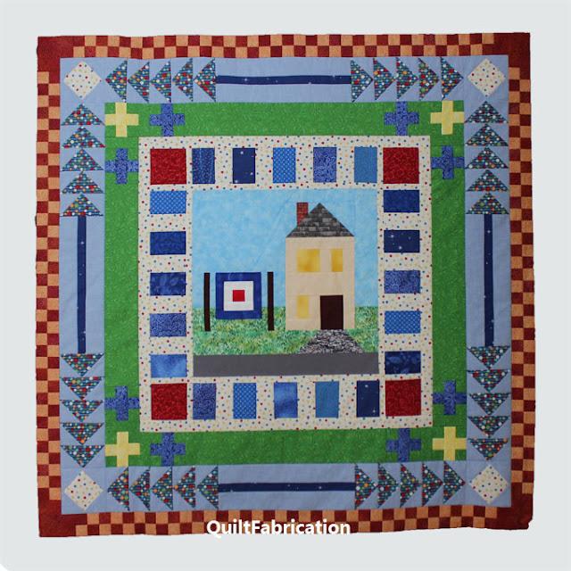 red and orange checkerboard quilt round