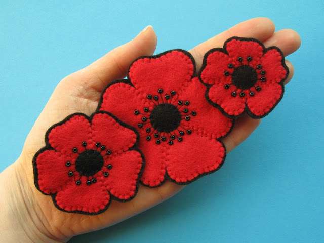 Three beaded felt poppy brooches