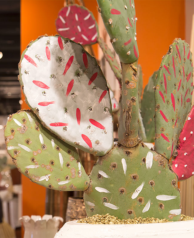 Add paint to a cactus for a modern potted plant display
