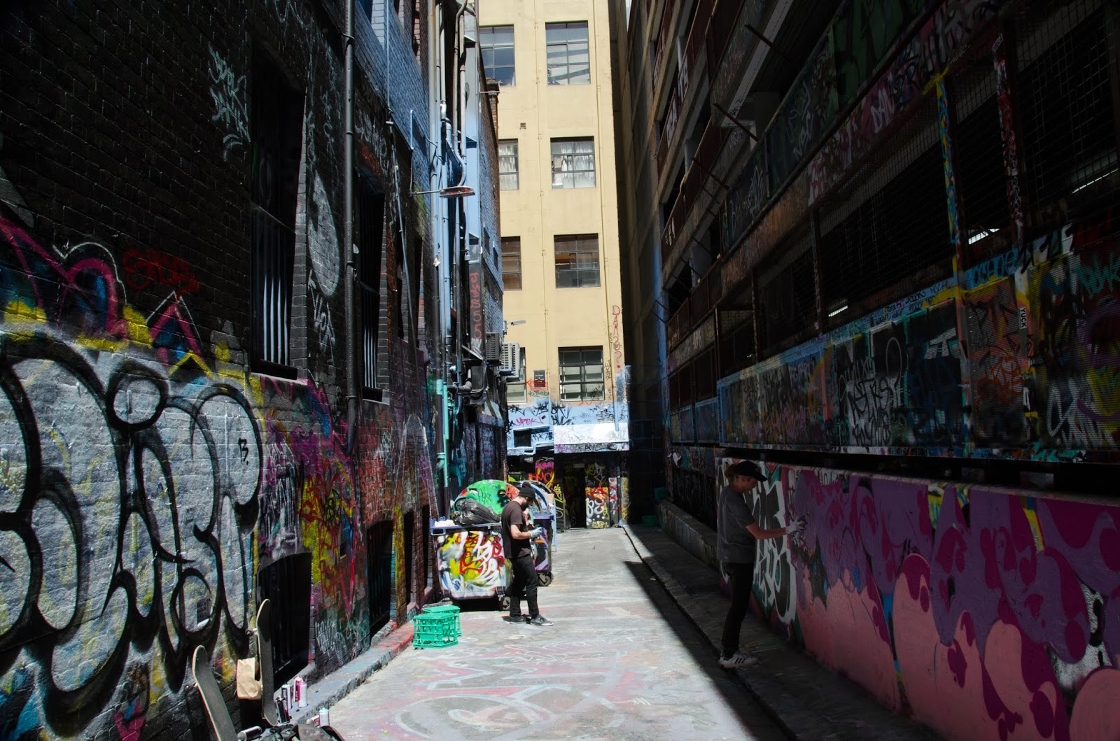 a grafitti artist at work at caledonian lane, melbourne.