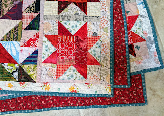 View of front, back, and binding of the LeMoyne Star string quilt