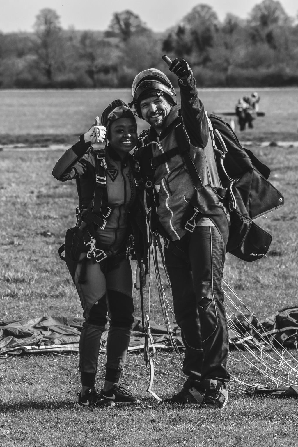 A black and white shot with my tandem instructor smiling with our thumbs up