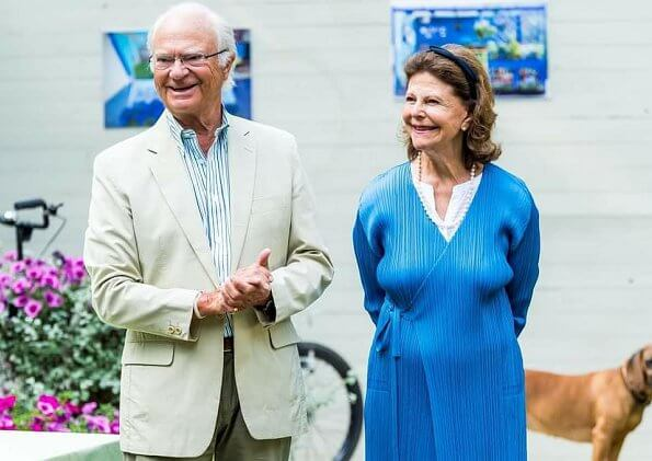 Queen Silvia wore a blue long cardigan from Issey Miyake. Pleats Please Issey Miyake long cardigan. Crown Princess Victoria and Princess Sofia