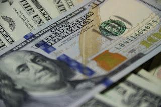 Stacks of $100 bills, and a close up of Benjamin Franklin.