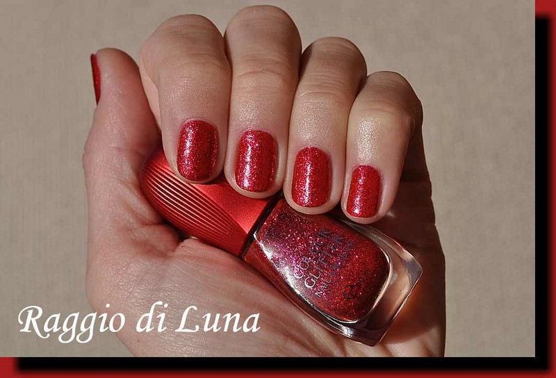 I Present To You The Nail Polish Kiko Colour Glitter Lacquer N 03 Full Red Photographs Outside In Sun Two Layers Of