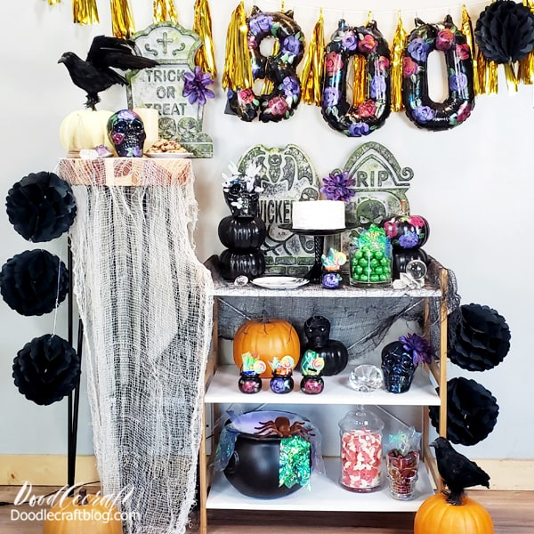 Gather all those old Halloween decorations that are collecting dust and paint them all to match your theme! I love loose florals and thought they would make the perfect look for this mystic Halloween party. They tie the decor together perfectly, all the colors match and the tombstones look real!