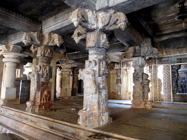 Intricately carved granite pillars depicting attendant maidens in the Bhoga Nandeeshwara Temple, Karnataka