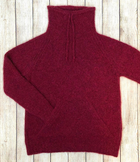 Sweater with funnel neck and pouch knitted with DROPS Air
