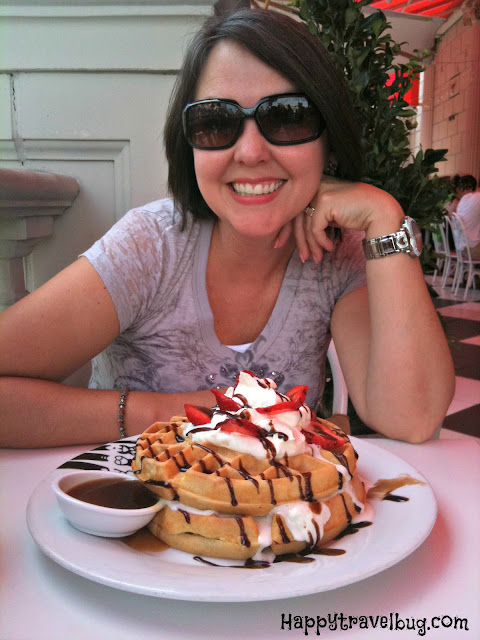 Me eating a giant plate of waffles