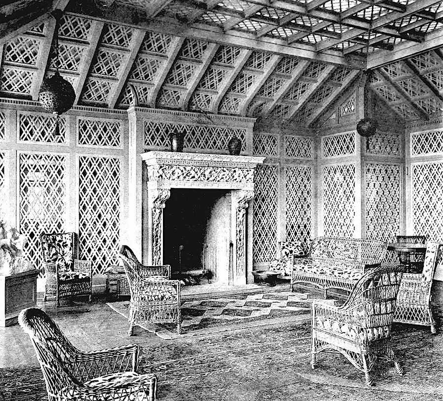 a photograph of an 1897 sun room with lots of wicker
